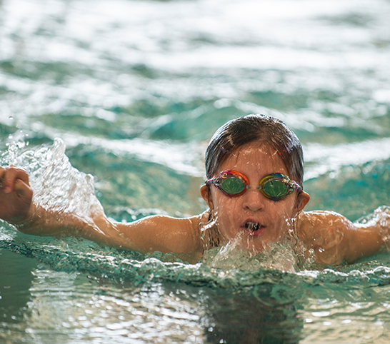 Girl swimming in the indoor pool at the Monon Community Center