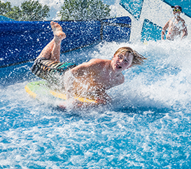Kid on the FlowRider at the Monon Community Center Waterpark
