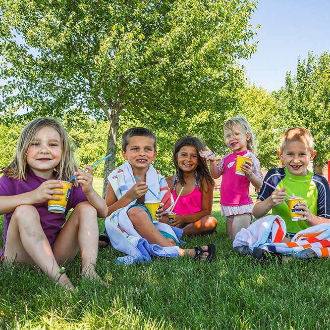 kids eating slushies at Lawrence Inlow Park