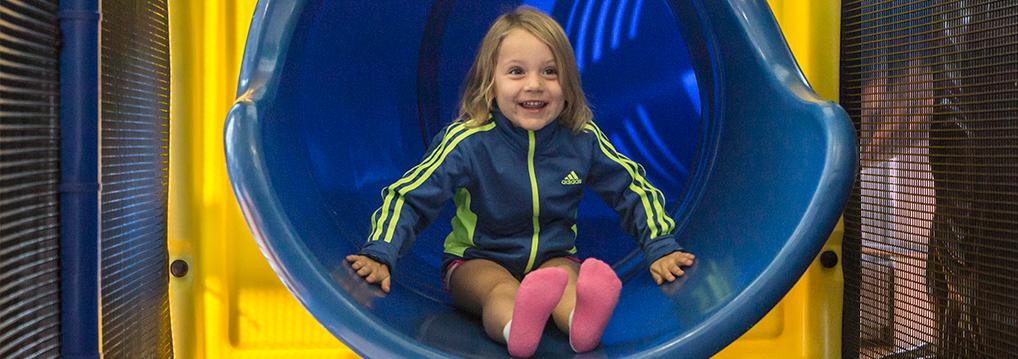 Girl on slide in Monon Community Center Kidzone