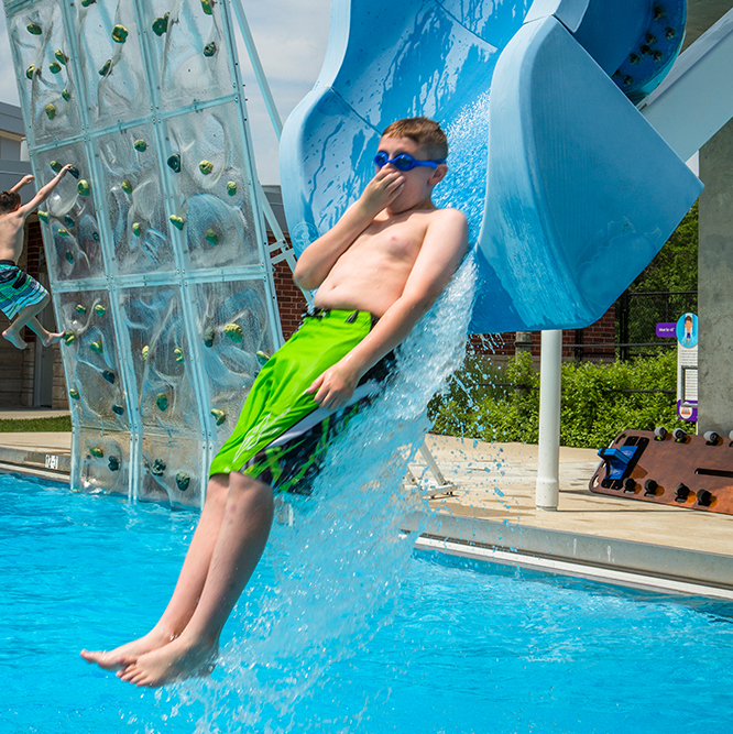 boy on the blue plunge slide