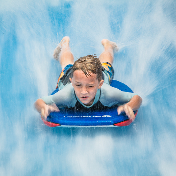 young boy on the flowrider