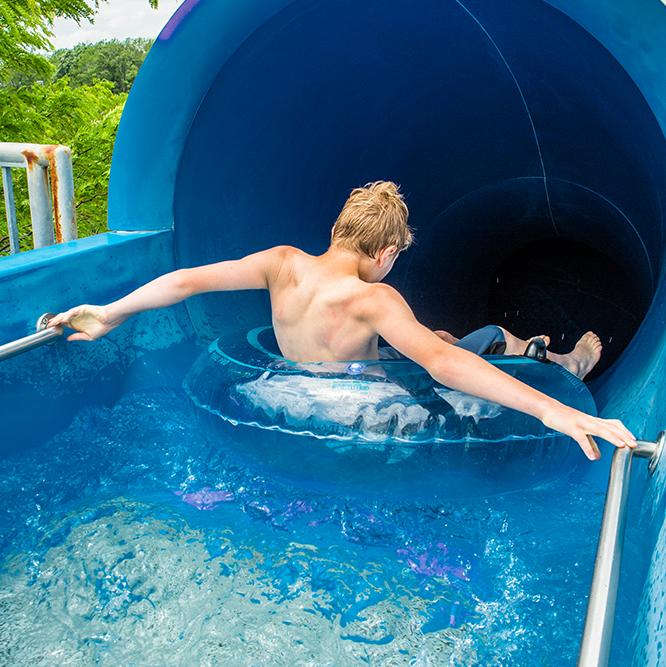Boy on blue slide
