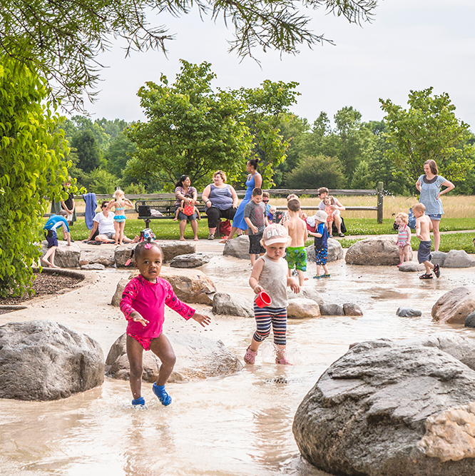kids playing in water at west park