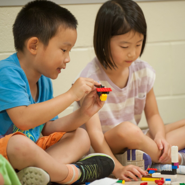 Kids building with legos in an adventures in art summer camp