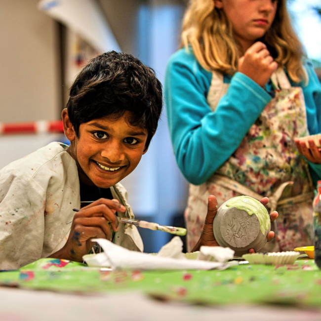 Kids painting in an adventures in art summer camp