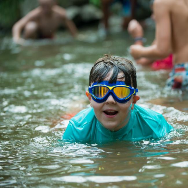 Kids splashing at a boys rock girls rule summer camp