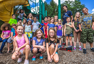 A group of kids at a Carmel playground at Extended School Enrichment and Summer Camp