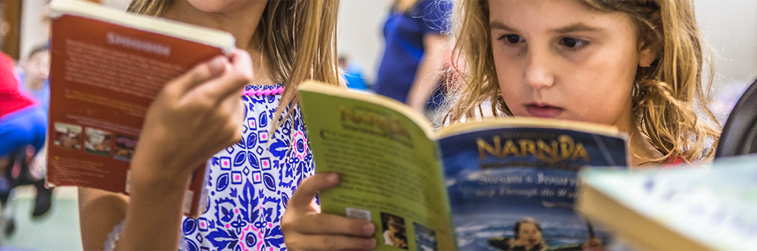 Child reading during Extended School Enrichment Program