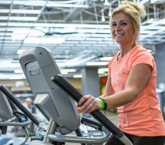 Woman on elliptical in the Fitness Center at the Monon Community Center