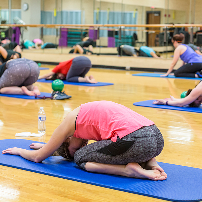 group stretching in a yoga class