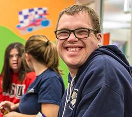 Smiling Participant in our adaptive programs for all ages and interests