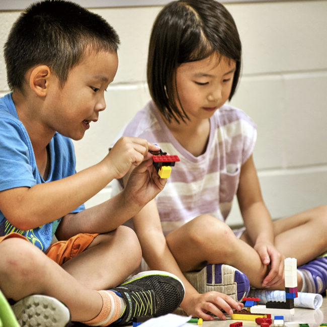 Kids playing and building in a science and technology program