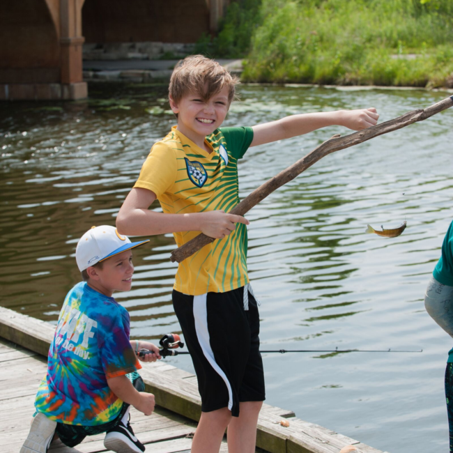 Kids fishing in a great outdoors summer camp