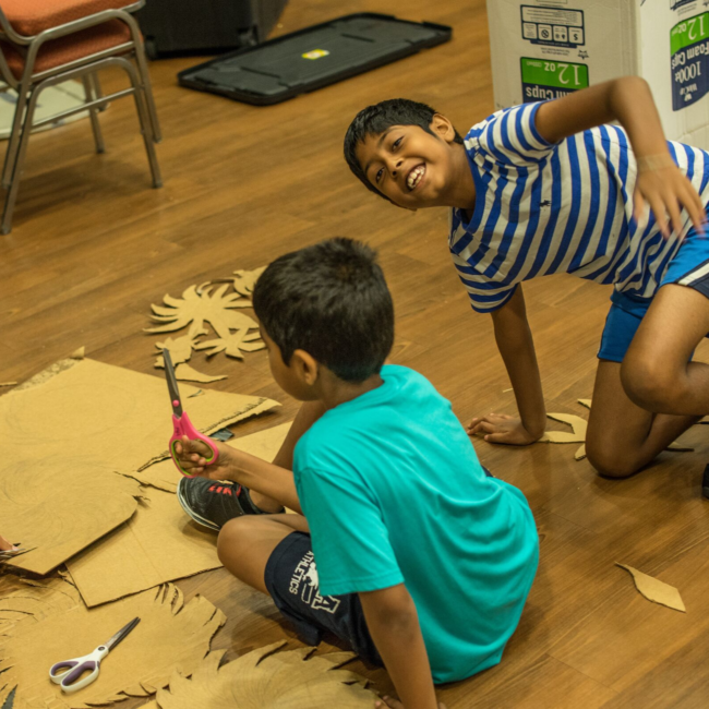 Boys creating props for a success on stage summer camp