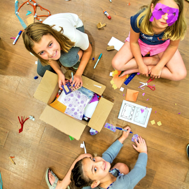 Girls creating props for a success on stage summer camp