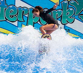 teenage girl on the flowrider at the Waterpark