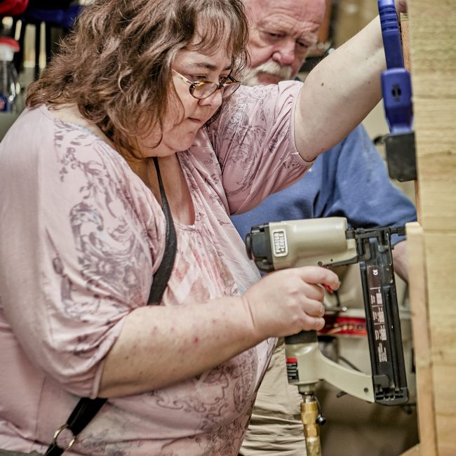 Woman woodworking in a senior program