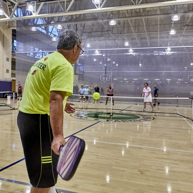 Volunteer playing Pickleball at the Monon Community Center