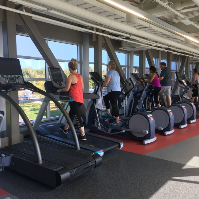 Girls on Elliptical and treadmill, included in gym membership at the Monon Community Center