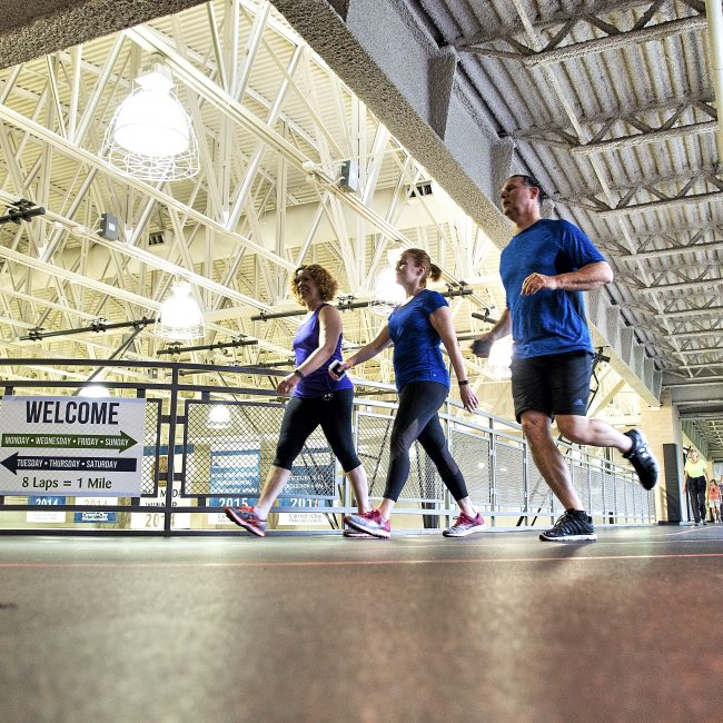 Group running on the indoor track at the gym in Carmel