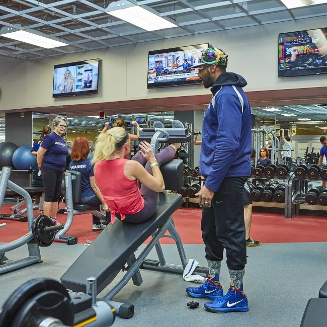 Personal Trainer instructing with fitness machines at the Monon Community Center