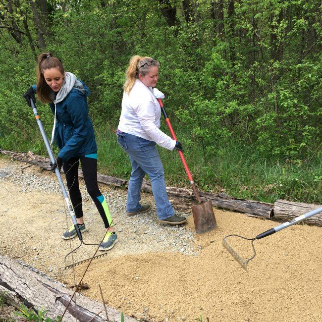 Volunteers shoveling limestone at West Park