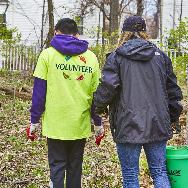 Two volunteers in the park