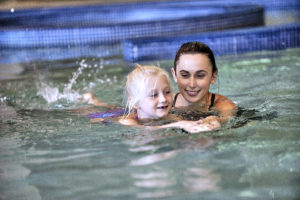 Girl taking swim lessons in the pool at the Monon Community Center (MCC)