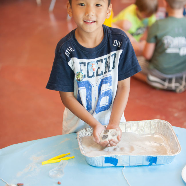 Kid playing with sand in a homeschool program at the Monon Community Center
