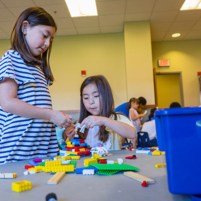 Girls building and playing with legos in a Homeschool Program at the Monon Community Center