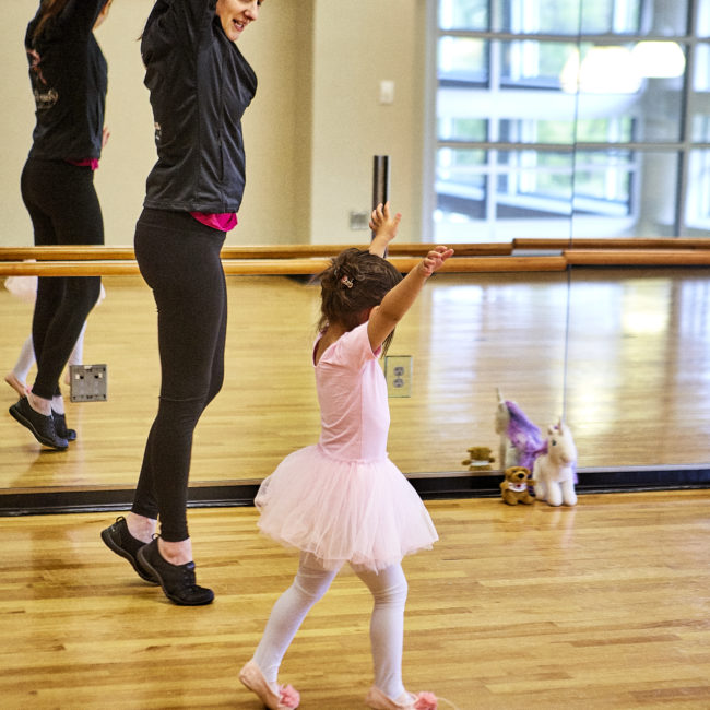 Instructor teaching a girl ballet in a Creative Arts dance program at the Monon Community Center