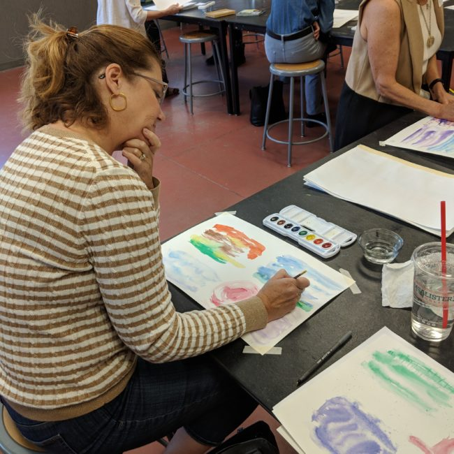 Woman painting in a creative arts program at the Monon Community Center