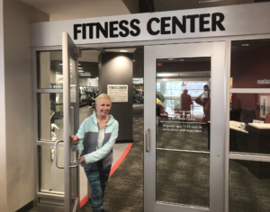 Diana entering the fitness center at the Monon Community Center