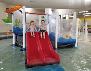 Kids on slides at the indoor pool