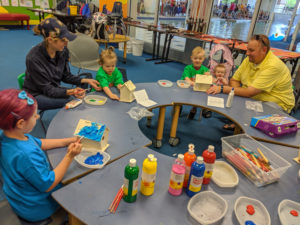 Participants and parents build bird houses during the Knee High Naturalist program. Summer 2019.