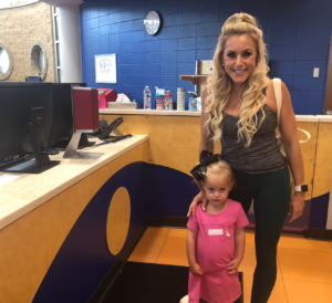 Lindy drops her daughter off at KidZone.