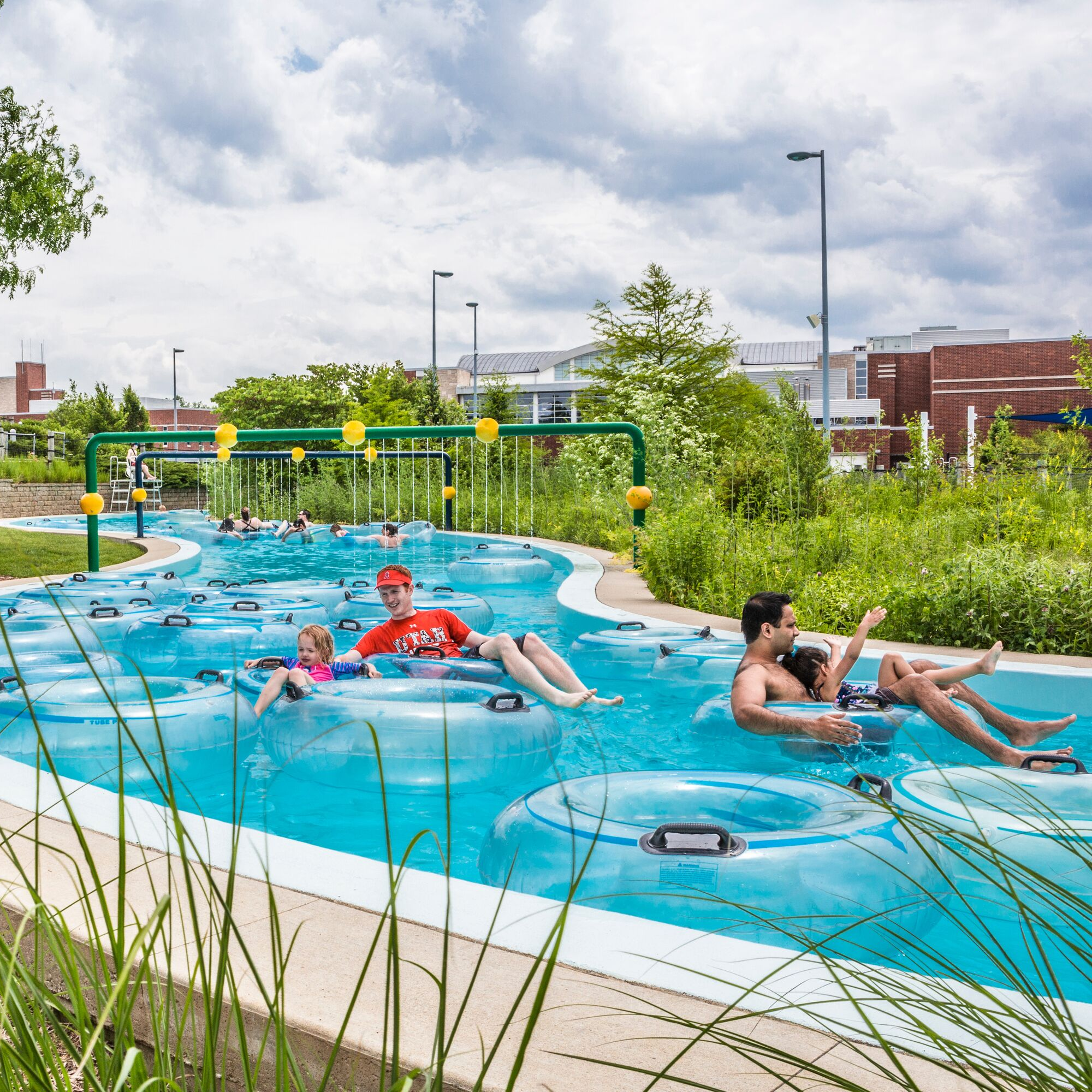 happy people floating in the lazy river in the sun