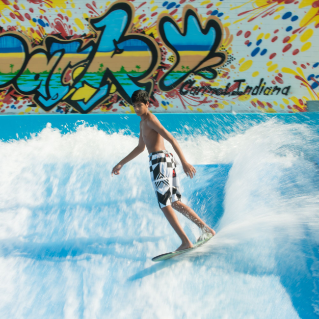 Kid surfing on the flow rider in the summer
