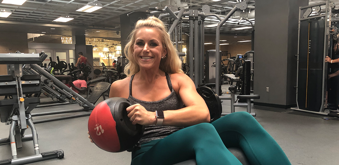 Lindy Fischer working out with a medicine ball