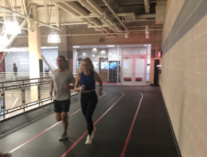 Lindy and Marcus Fischer warming up for a workout on the indoor track at the Monon Community Center.