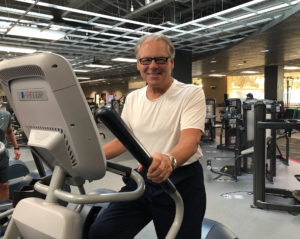 Dan Gooliak working out on elliptical at MCC Fitness Center