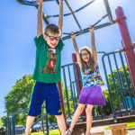 Children playing on monkey bars at Carey Grove Park