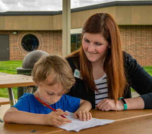 Aimee Riche assists student with homework during ESE