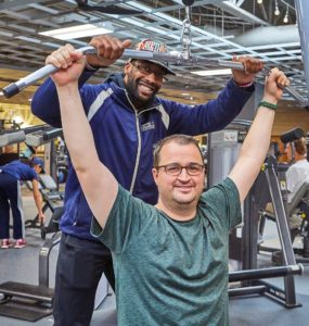 Ryan with his personal trainer at the Monon Community Center