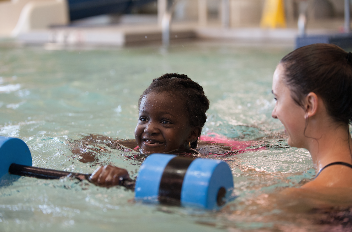 Swim instructor working with participant