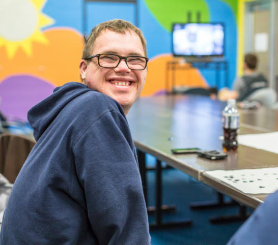 Boy smiling in an adaptive program