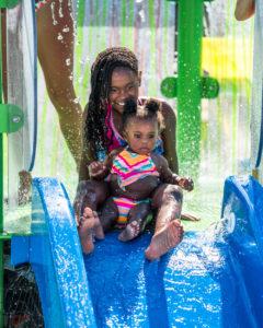Girls on the slide in the kiddie pool