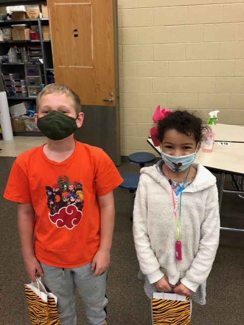 Two kids with masks